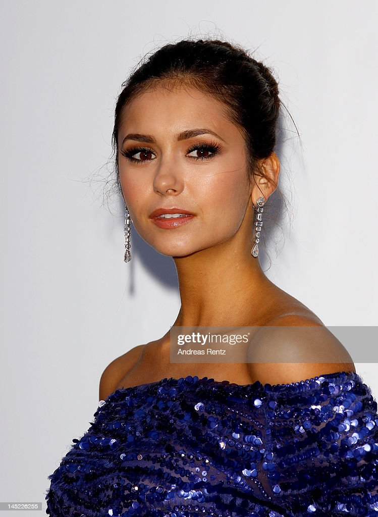 Actress <a gi-track='captionPersonalityLinkClicked' href=/galleries/search?phrase=Nina+Dobrev&family=editorial&specificpeople=4397485 ng-click='$event.stopPropagation()'>Nina Dobrev</a> arrives at the 2012 amfAR's Cinema Against AIDS during the 65th Annual Cannes Film Festival at Hotel Du Cap on May 24, 2012 in Cap D'Antibes, France.