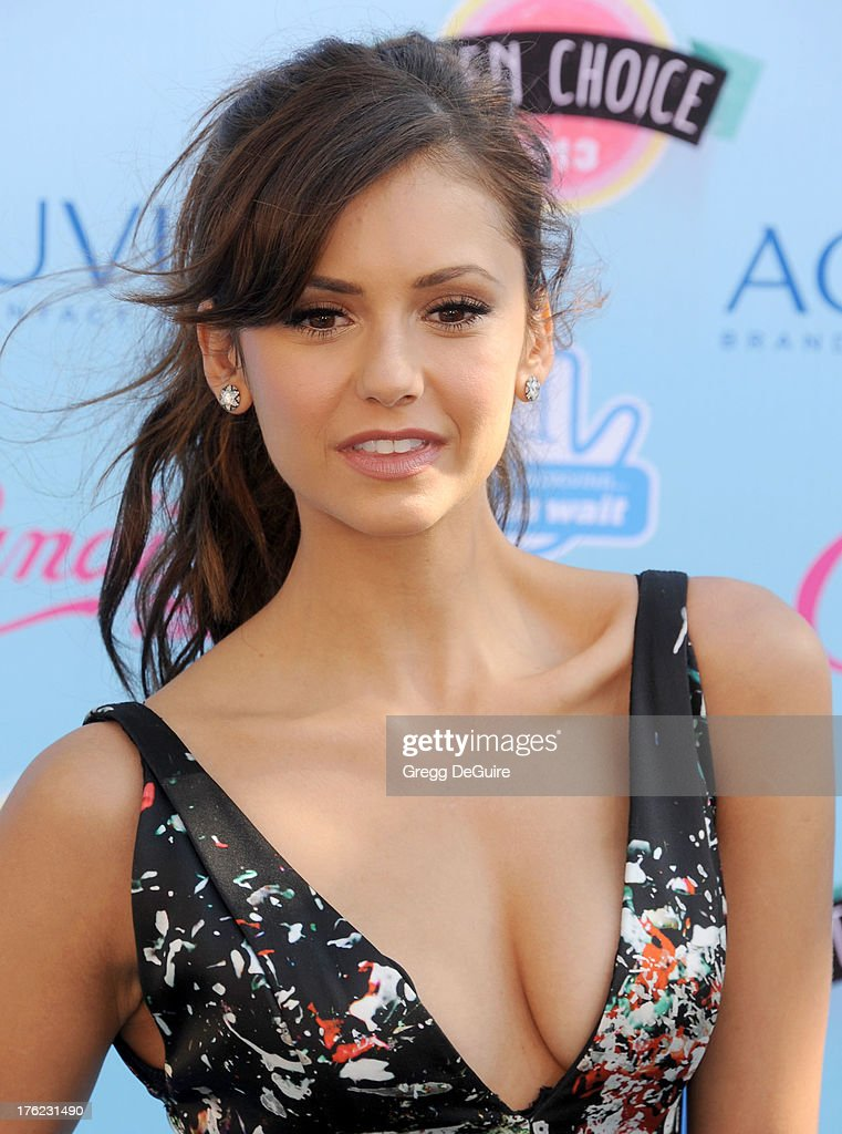 Actress Nina Dobrev arrives at the 2013 Teen Choice Awards at Gibson Amphitheatre on August 11, 2013 in Universal City, California.