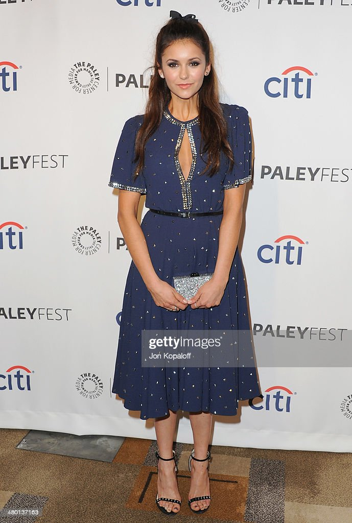 Actress <a gi-track='captionPersonalityLinkClicked' href=/galleries/search?phrase=Nina+Dobrev&family=editorial&specificpeople=4397485 ng-click='$event.stopPropagation()'>Nina Dobrev</a> arrives at the 2014 PaleyFest - 'The Vampire Diaries' & 'The Originals' on March 22, 2014 in Hollywood, California.