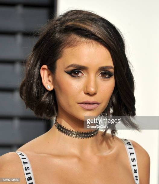 Actress Nina Dobrev arrives at the 2017 Vanity Fair Oscar Party Hosted By Graydon Carter at Wallis Annenberg Center for the Performing Arts on...