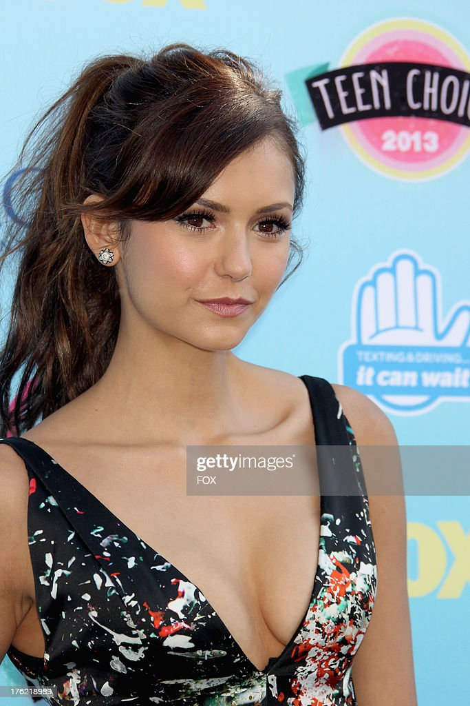 Actress Nina Dobrev arrives at the Fox Teen Choice Awards 2013 held at the Gibson Amphitheatre on August 11, 2013 in Los Angeles, California.
