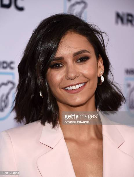 Actress Nina Dobrev arrives at the Natural Resources Defense Council's STAND UP event at the Wallis Annenberg Center for the Performing Arts on April...