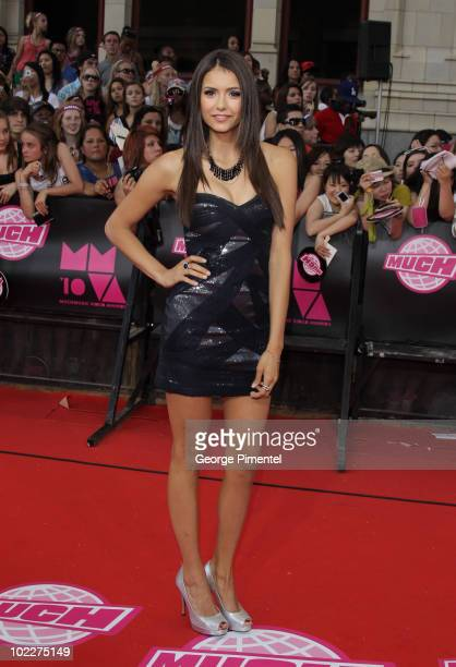 Actress Nina Dobrev arrives on the red carpet of the 21st Annual MuchMusic Video Awards at the MuchMusic HQ on June 20 2010 in Toronto Canada