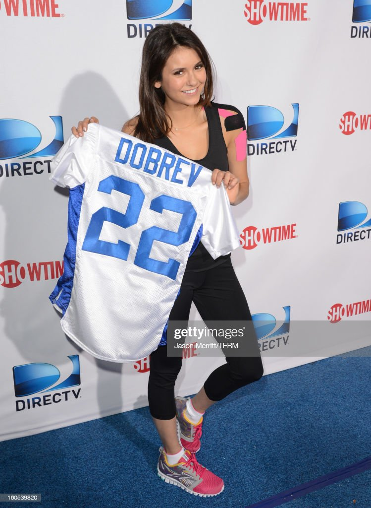 Actress <a gi-track='captionPersonalityLinkClicked' href=/galleries/search?phrase=Nina+Dobrev&family=editorial&specificpeople=4397485 ng-click='$event.stopPropagation()'>Nina Dobrev</a> attends DIRECTV'S Seventh Annual Celebrity Beach Bowl at DTV SuperFan Stadium at Mardi Gras World on February 2, 2013 in New Orleans, Louisiana.