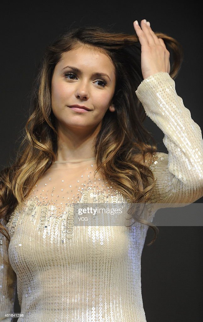 Actress <a gi-track='captionPersonalityLinkClicked' href=/galleries/search?phrase=Nina+Dobrev&family=editorial&specificpeople=4397485 ng-click='$event.stopPropagation()'>Nina Dobrev</a> attends LUX promotional event on July 3, 2014 in Beijing, China.