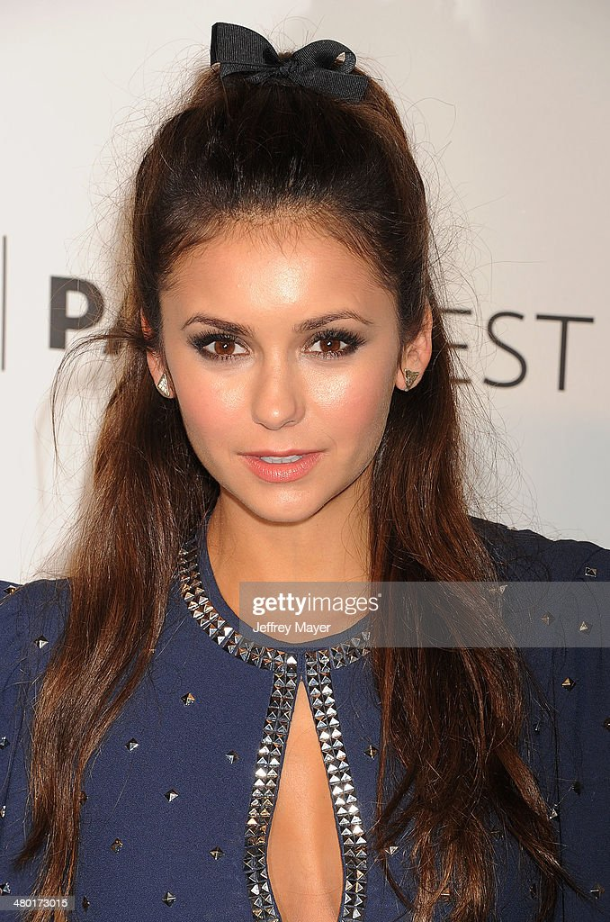 Actress <a gi-track='captionPersonalityLinkClicked' href=/galleries/search?phrase=Nina+Dobrev&family=editorial&specificpeople=4397485 ng-click='$event.stopPropagation()'>Nina Dobrev</a> attends the 2014 PaleyFest - 'The Vampire Diaries' & 'The Originals' held at Dolby Theatre on March 21, 2014 in Hollywood, California.