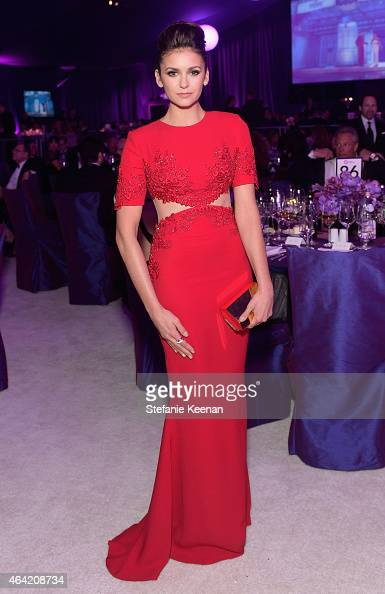 Actress Nina Dobrev attends the 23rd Annual Elton John AIDS Foundation Academy Awards viewing party with Chopard on February 22 2015 in Los Angeles...