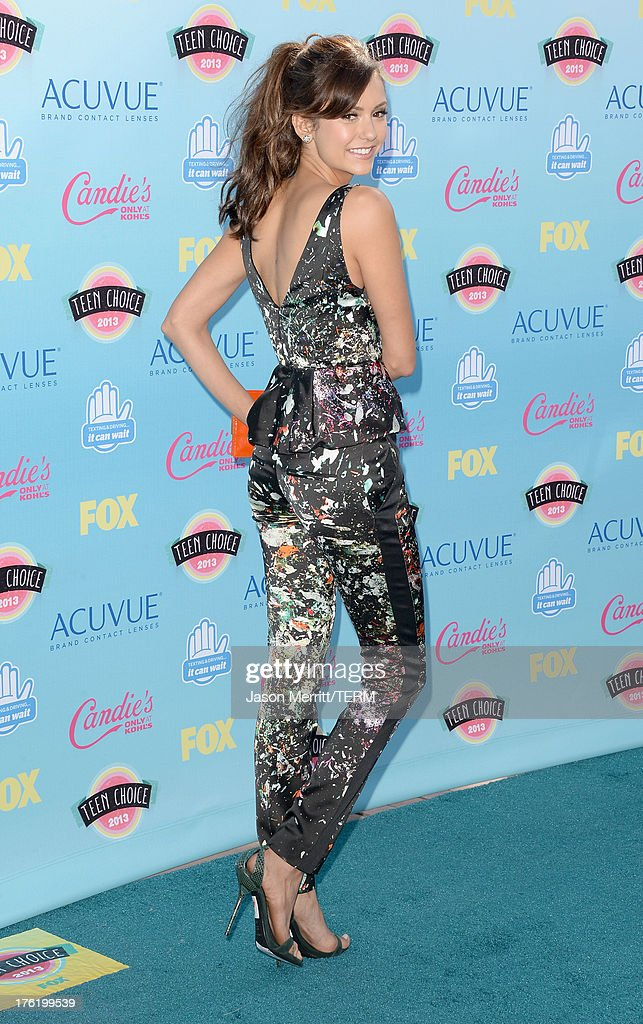 Actress Nina Dobrev attends the Teen Choice Awards 2013 at Gibson Amphitheatre on August 11, 2013 in Universal City, California.
