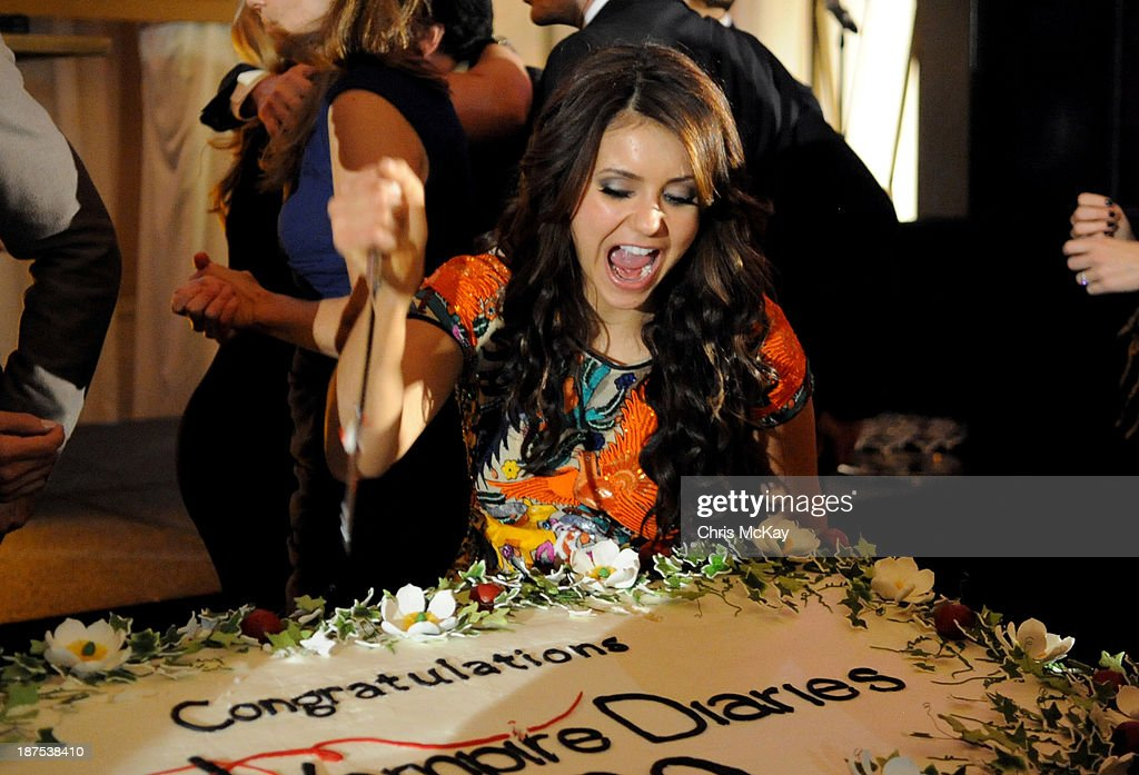 Actress <a gi-track='captionPersonalityLinkClicked' href=/galleries/search?phrase=Nina+Dobrev&family=editorial&specificpeople=4397485 ng-click='$event.stopPropagation()'>Nina Dobrev</a> attends The Vampire Diaries 100th Episode Celebration on November 9, 2013 in Atlanta, Georgia.