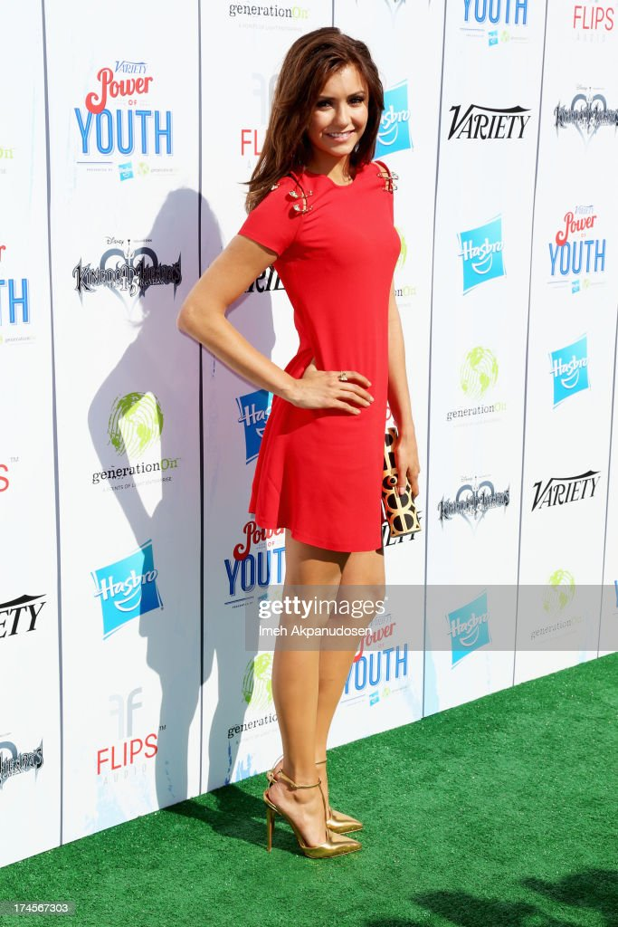 Actress <a gi-track='captionPersonalityLinkClicked' href=/galleries/search?phrase=Nina+Dobrev&family=editorial&specificpeople=4397485 ng-click='$event.stopPropagation()'>Nina Dobrev</a> attends Variety's Power of Youth presented by Hasbro, Inc. and generationOn at Universal Studios Backlot on July 27, 2013 in Universal City, California.