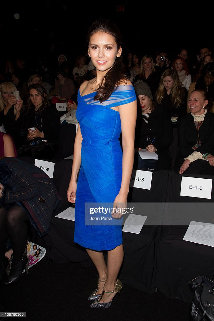 Actress <a gi-track='captionPersonalityLinkClicked' href=/galleries/search?phrase=Nina+Dobrev&family=editorial&specificpeople=4397485 ng-click='$event.stopPropagation()'>Nina Dobrev</a> is seen at the Monique Lhuillier Fall 2012 show at Lincoln Center during Fall 2012 Mercedes-Benz Fashion Week on February 11, 2012 in New York City.
