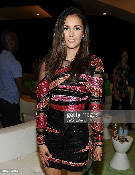 Actress Nina Dobrev poses in the green room at the 2015 Teen Choice Awards at Galen Center on August 16 2015 in Los Angeles California