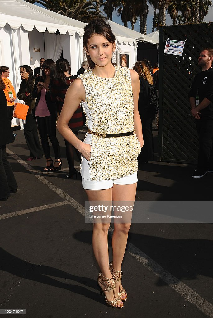 Actress Nina Dobrev poses in the Piaget Lounge during The 2013 Film Independent Spirit Awards on February 23, 2013 in Santa Monica, California.