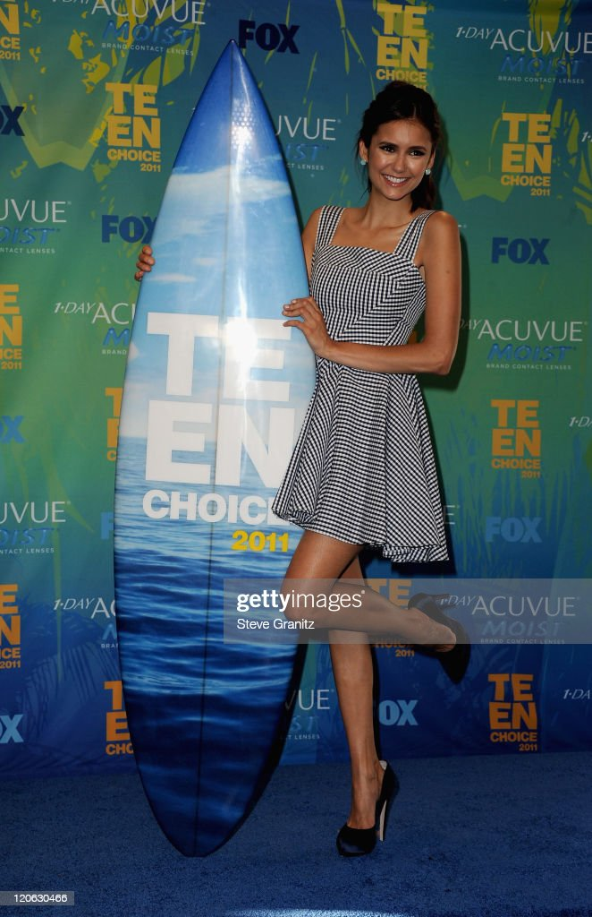 Actress <a gi-track='captionPersonalityLinkClicked' href=/galleries/search?phrase=Nina+Dobrev&family=editorial&specificpeople=4397485 ng-click='$event.stopPropagation()'>Nina Dobrev</a> poses in the press room at the 2011 Teen Choice Awards held at the Gibson Amphitheatre on August 7, 2011 in Universal City, California.