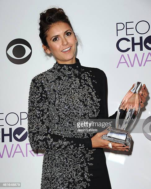 Actress Nina Dobrev poses in the press room at the 40th annual People's Choice Awards at Nokia Theatre LA Live on January 8 2014 in Los Angeles...