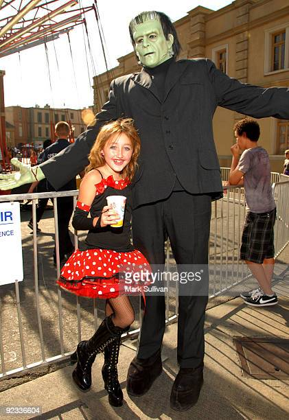 Actress Noah Cyrus poses with Frankenstein charactor at the Camp Ronald McDonald For Good Times 17th Annual Halloween Carnival at Universal Studios...
