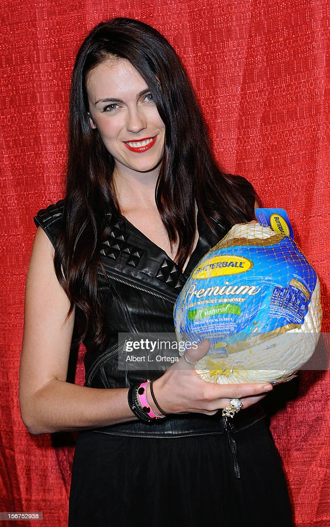 Actress Noelle Toland arrives for Jackson Limousine Homeless Turkey Drive Red Carpet Gala held at Infusion Lounge on November 19, 2012 in Universal City, California.