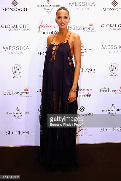 Actress Noemie Lenoir pregnant attends the Global Gift Gala Photocall Held at Four Seasons Hotel George V on May 25 2015 in Paris France