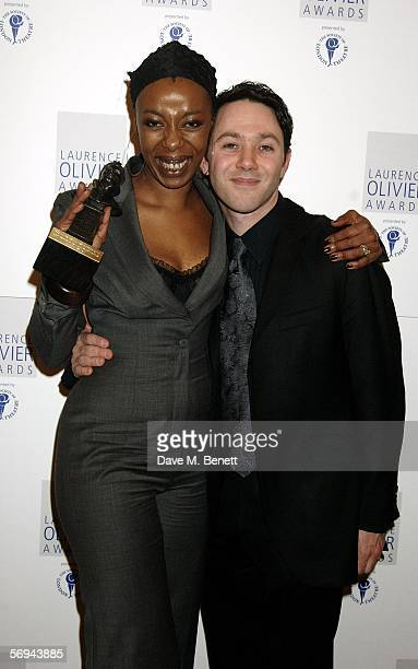 Actress Noma Dumezweni poses in the Awards Room with the award for Best Performance in a Supporting Role for A Raisin in the Sun with actor Reece...