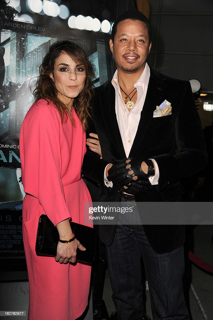 Actress Noomi Rapace and actor Terrence Howard arriveto the premiere of FilmDistricts's 'Dead Man Down' at ArcLight Hollywood on February 26, 2013 in Hollywood, California.