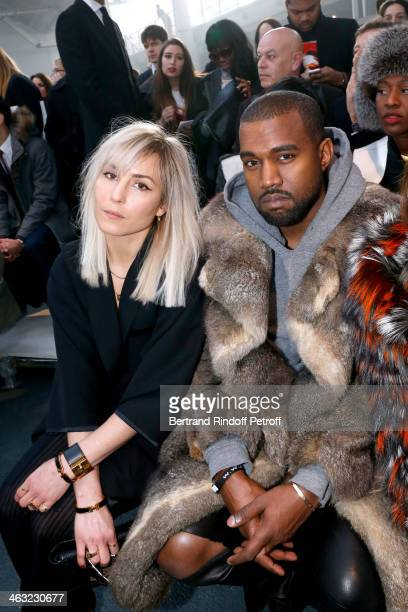 Actress Noomi Rapace and singer Kanye West attend the Givenchy Menswear Fall/Winter 20142015 Show as part of Paris Fashion Week Held at Halle...