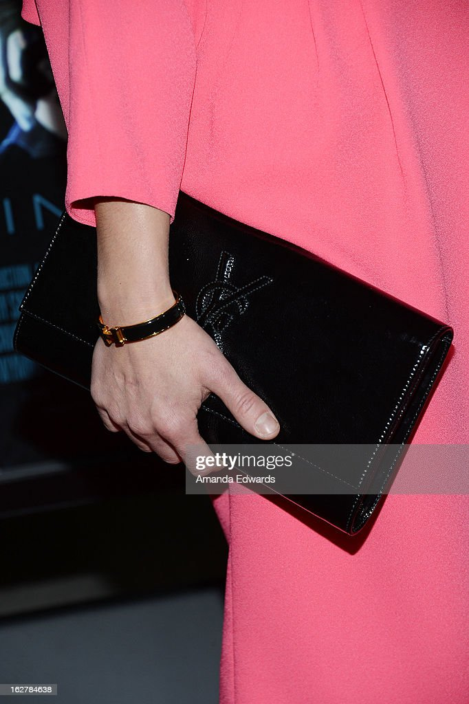Actress Noomi Rapace (clutch detail) arrives at the Los Angeles Premiere of 'Dead Man Down' at ArcLight Hollywood on February 26, 2013 in Hollywood, California.