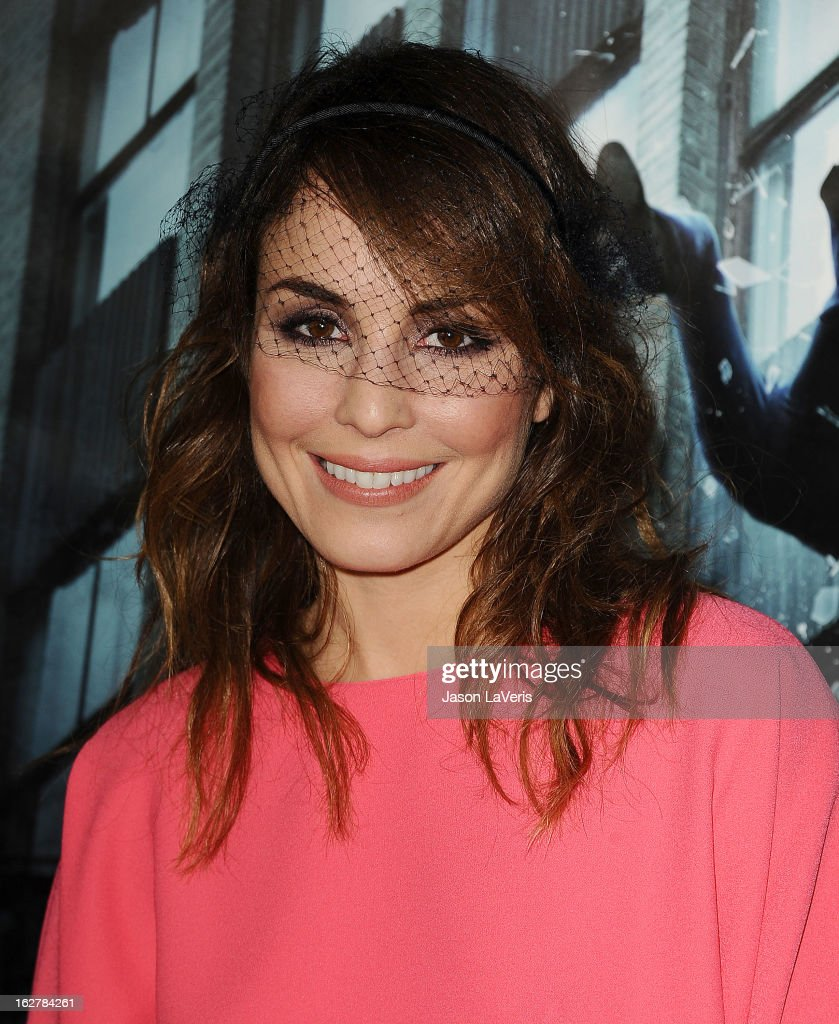 Actress <a gi-track='captionPersonalityLinkClicked' href=/galleries/search?phrase=Noomi+Rapace&family=editorial&specificpeople=4522889 ng-click='$event.stopPropagation()'>Noomi Rapace</a> attends the premiere of 'Dead Man Down' at ArcLight Cinemas on February 26, 2013 in Hollywood, California.