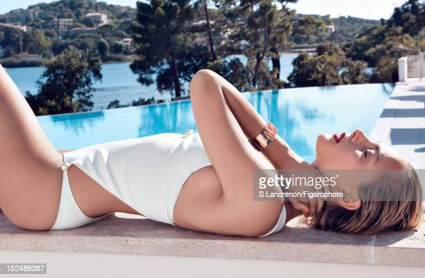 Actress Nora Arnezeder poses for Madame Figaro on June 18 2012 in Corscia France PUBLISHED IMAGE Figaro ID 103882020 Swimsuit by Chanel bracelet by...