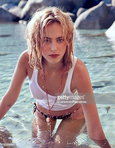 Actress Nora Arnezeder poses for Madame Figaro on June 18 2012 in Corscia France Figaro ID 103882025 Tank top by Zadig Voltaire bikini bottoms by...