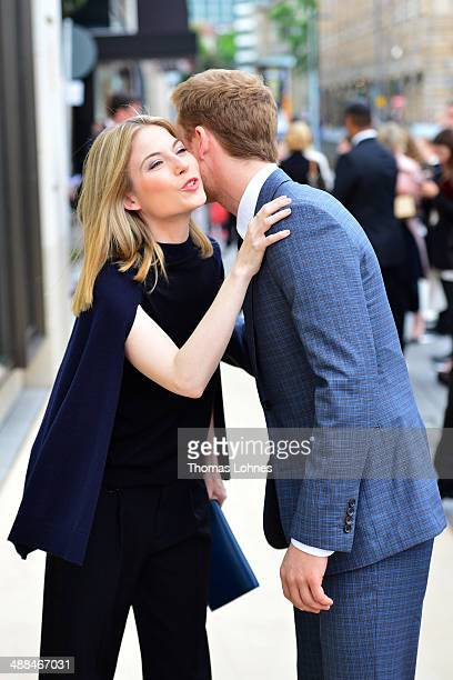 Actress Norah von Waldstaetten and actor Alexander Fehling greet each other at the Louis Vuitton Global Store Opening on May 6 2014 in Frankfurt am...