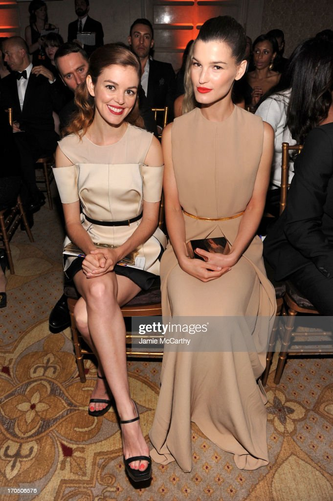Actress Nora Zehetner (L) and photographer Hanneli Mustaparta watch the runway show during the 4th Annual amfAR Inspiration Gala New York at The Plaza Hotel on June 13, 2013 in New York City.