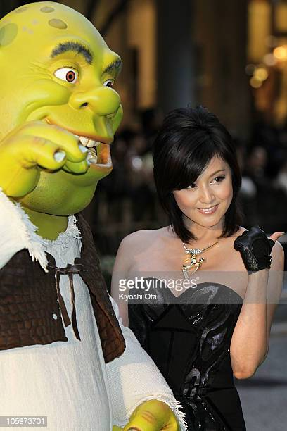 Actress Norika Fujiwara and a 'Shrek' character attend the 23rd Tokyo International Film Festival Opening Ceremony at Roppongi Hills on October 23...