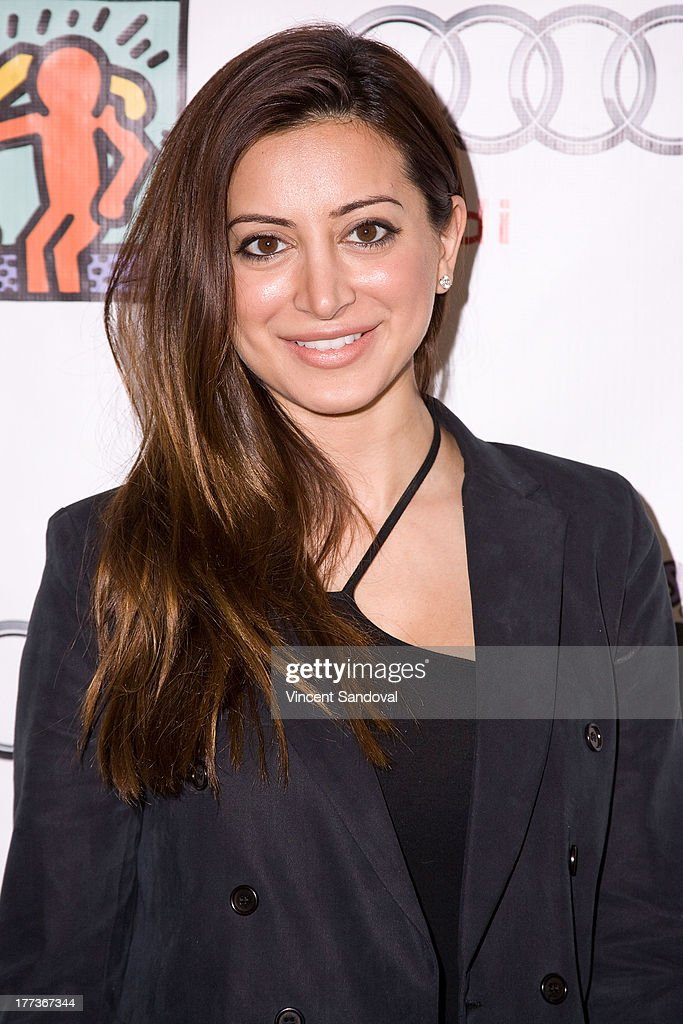 Actress Noureen DeWulf attends the Best Buddies poker event at Audi Beverly Hills on August 22, 2013 in Beverly Hills, California.