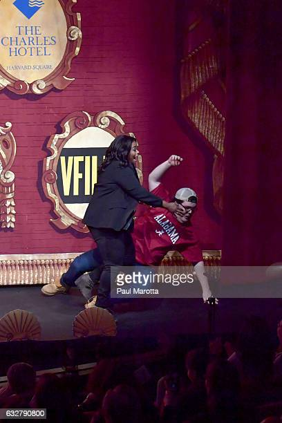 Actress Octavia Spencer tackles the 'Alabama Football Fan' actor Daniel Hughes onstage during the roast at the The Hasty Pudding Theatricals...