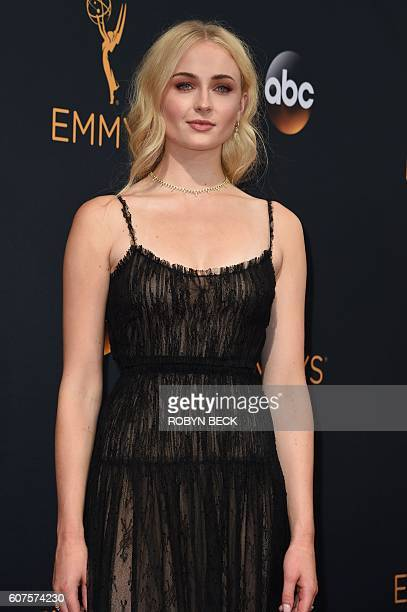 Actress of the serie 'Games of Thrones' Sophie Turner arrives for the 68th Emmy Awards on September 18 2016 at the Microsoft Theatre in Los Angeles /...