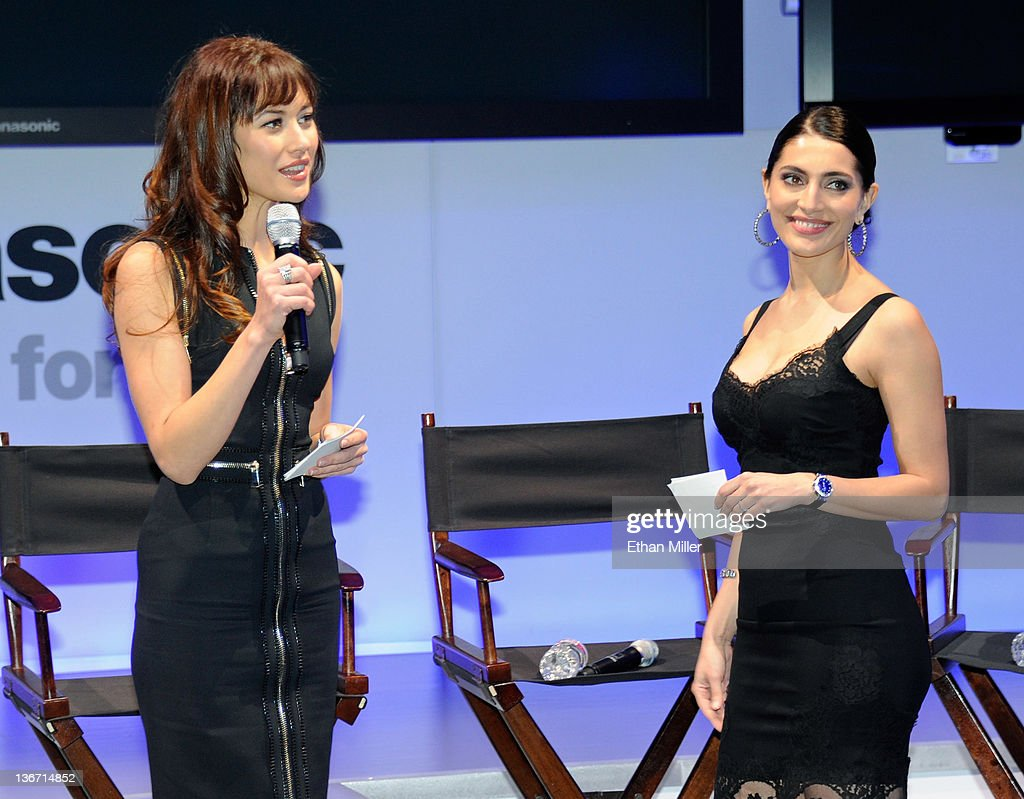 Actress Olga Kurylenko (L), a 'Bond Girl' from the James Bond movie, 'Quantum of Solace,' and fellow 'Bond Girl,' actress Caterina Murino from the movie, 'Casino Royale,' appear at the Panasonic booth as MGM Studios and Twentieth Century Fox Home Entertainment unveil 'Bond 50,' a box-set featuring all 22 James Bond films on Blu-ray Disc in celebration of the James Bond franchise's 50th anniversary at the 2012 International Consumer Electronics Show at the Las Vegas Convention Center January 10, 2012 in Las Vegas, Nevada. CES, the world's largest annual consumer technology trade show, runs through January 13 and is expected to feature 2,700 exhibitors showing off their latest products and services to about 140,000 attendees.