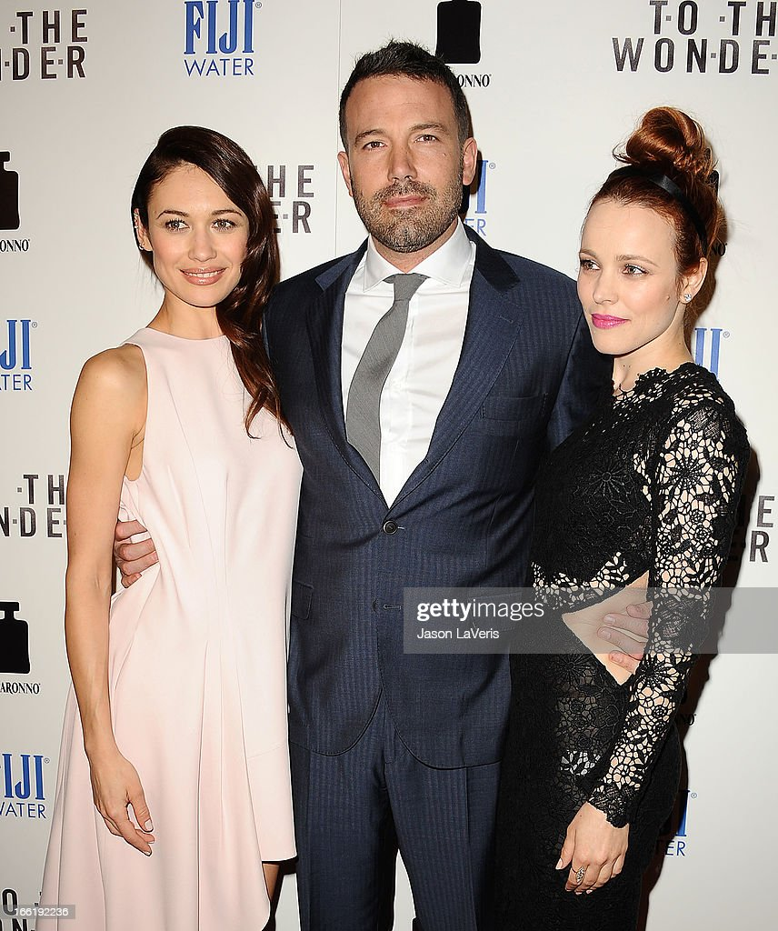 Actress <a gi-track='captionPersonalityLinkClicked' href=/galleries/search?phrase=Olga+Kurylenko&family=editorial&specificpeople=630281 ng-click='$event.stopPropagation()'>Olga Kurylenko</a>, actor <a gi-track='captionPersonalityLinkClicked' href=/galleries/search?phrase=Ben+Affleck&family=editorial&specificpeople=201856 ng-click='$event.stopPropagation()'>Ben Affleck</a> and actress <a gi-track='captionPersonalityLinkClicked' href=/galleries/search?phrase=Rachel+McAdams&family=editorial&specificpeople=212942 ng-click='$event.stopPropagation()'>Rachel McAdams</a> attend the premiere of 'To The Wonder' at Pacific Design Center on April 9, 2013 in West Hollywood, California.
