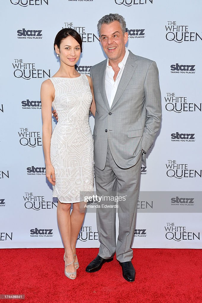 Actress <a gi-track='captionPersonalityLinkClicked' href=/galleries/search?phrase=Olga+Kurylenko&family=editorial&specificpeople=630281 ng-click='$event.stopPropagation()'>Olga Kurylenko</a> (L) and actor <a gi-track='captionPersonalityLinkClicked' href=/galleries/search?phrase=Danny+Huston&family=editorial&specificpeople=211465 ng-click='$event.stopPropagation()'>Danny Huston</a> arrive at 'Cocktails with the Queen' - the British Consulate's toast to the U.S launch of the Starz original series 'The White Queen' at the British Consul General's Residence on July 25, 2013 in Los Angeles, California.