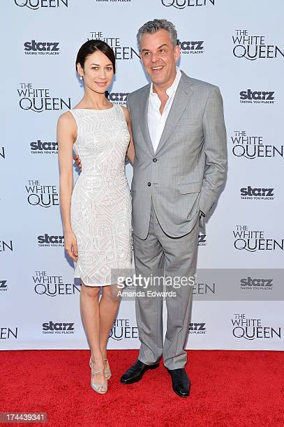 Actress Olga Kurylenko and actor Danny Huston arrive at 'Cocktails with the Queen' the British Consulate's toast to the US launch of the Starz...