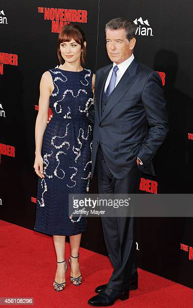 Actress Olga Kurylenko and actor Pierce Brosnan arrive at the Los Angeles premiere of 'The November Man' at TCL Chinese Theatre on August 13 2014 in...