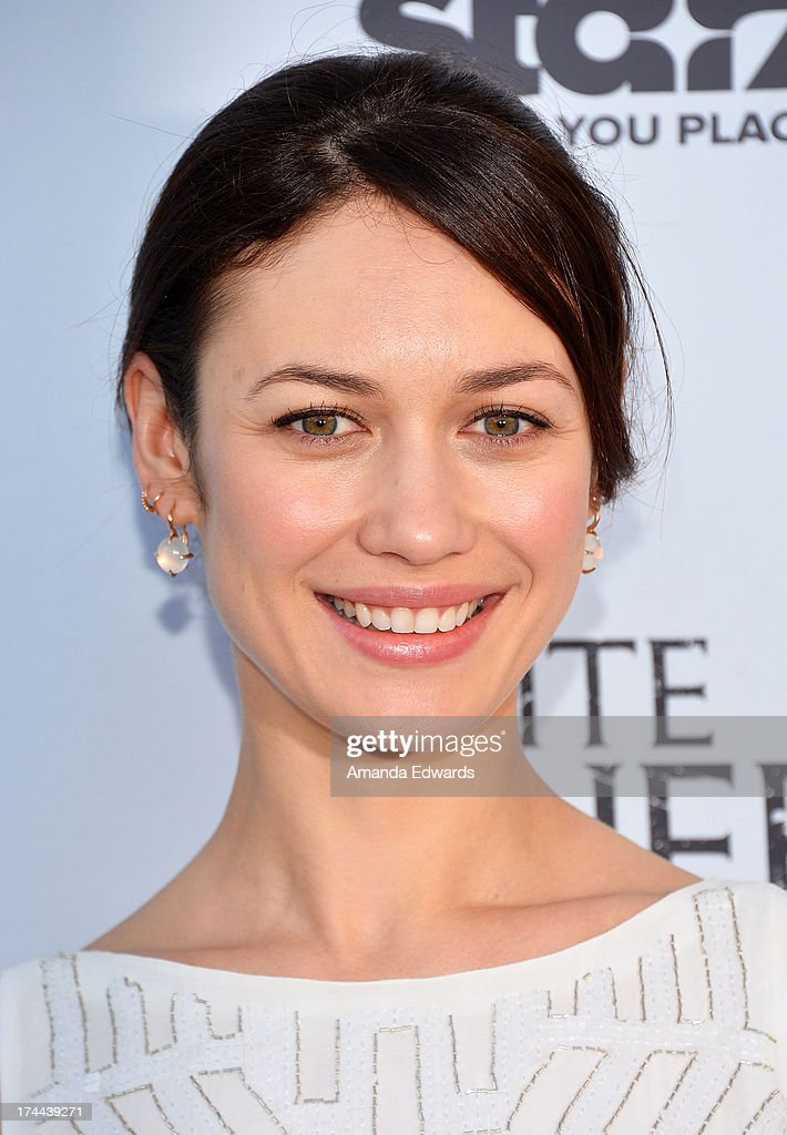 Actress <a gi-track='captionPersonalityLinkClicked' href=/galleries/search?phrase=Olga+Kurylenko&family=editorial&specificpeople=630281 ng-click='$event.stopPropagation()'>Olga Kurylenko</a> arrives at 'Cocktails with the Queen' - the British Consulate's toast to the U.S launch of the Starz original series 'The White Queen' at the British Consul General's Residence on July 25, 2013 in Los Angeles, California.