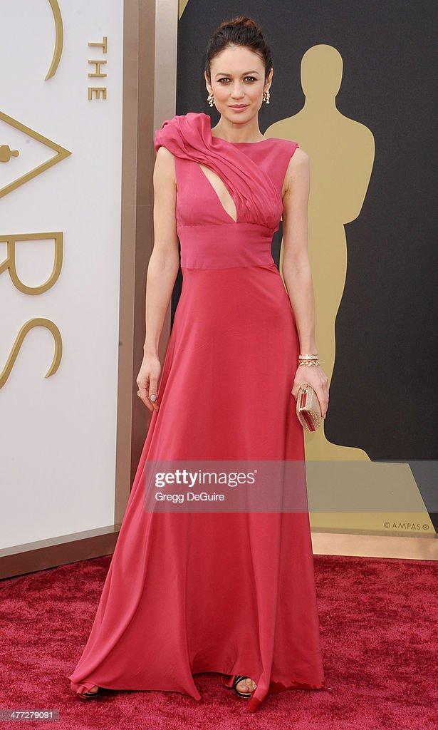 Actress Olga Kurylenko arrives at the 86th Annual Academy Awards at Hollywood & Highland Center on March 2, 2014 in Hollywood, California.