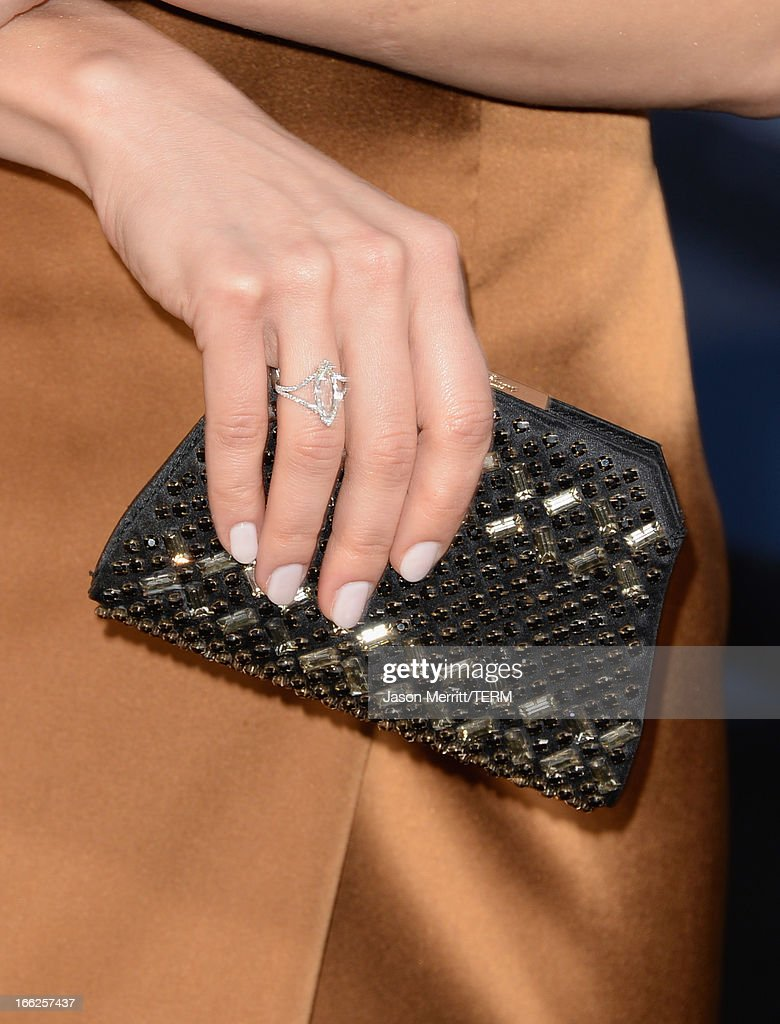 Actress Olga Kurylenko (jewelry detail) arrives at the premiere of Universal Pictures' 'Oblivion' at Dolby Theatre on April 10, 2013 in Hollywood, California.