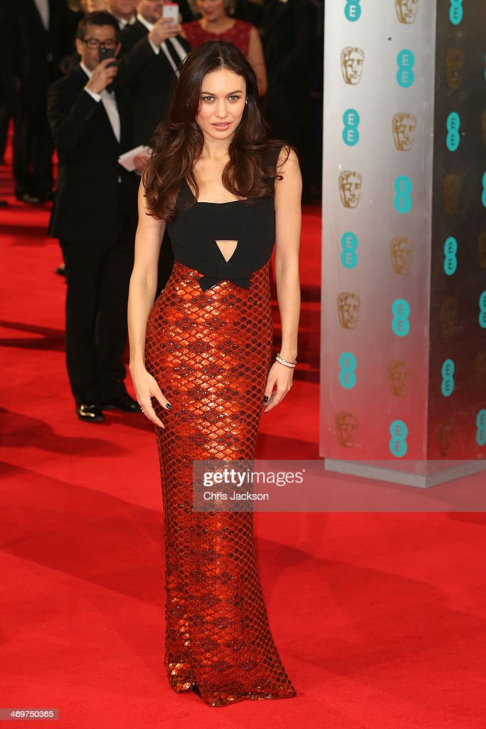 Actress <a gi-track='captionPersonalityLinkClicked' href=/galleries/search?phrase=Olga+Kurylenko&family=editorial&specificpeople=630281 ng-click='$event.stopPropagation()'>Olga Kurylenko</a> attends the EE British Academy Film Awards 2014 at The Royal Opera House on February 16, 2014 in London, England.