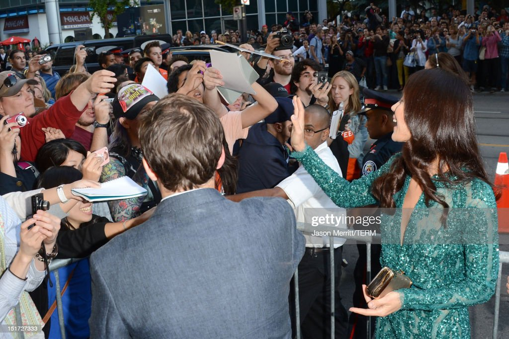Actress <a gi-track='captionPersonalityLinkClicked' href=/galleries/search?phrase=Olga+Kurylenko&family=editorial&specificpeople=630281 ng-click='$event.stopPropagation()'>Olga Kurylenko</a> signs autographs for eager fans at the 'To The Wonder' premiere during the 2012 Toronto International Film Festival at the Princess of Wales Theatre on September 10, 2012 in Toronto, Canada.