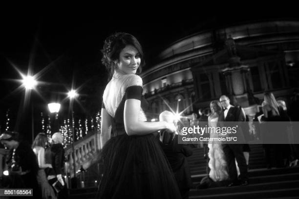 Actress Olga Kurylenko walks the red carpet during The Fashion Awards 2017 in partnership with Swarovski at Royal Albert Hall on December 4 2017 in...