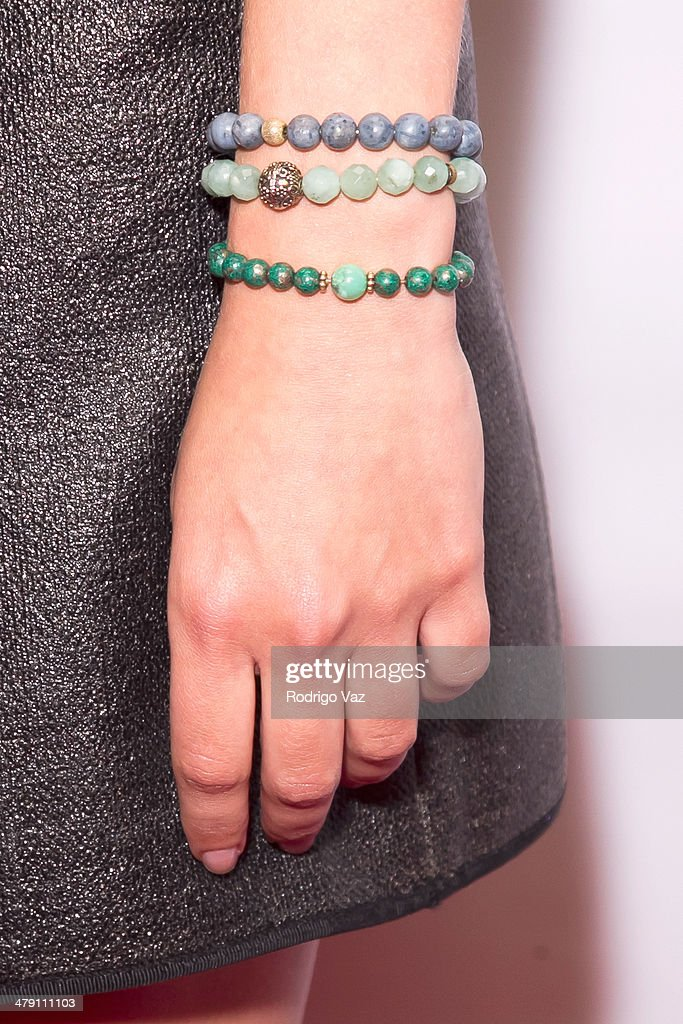 Actress Olive Allen (jewelry detail) attends The Dream Builders Project 'A Brighter Future For Children' at H.O.M.E. on March 15, 2014 in Beverly Hills, California.