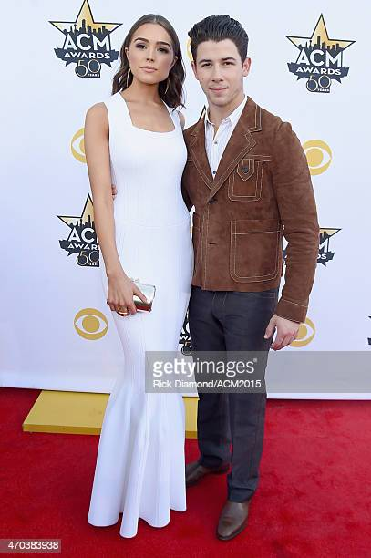 Actress Olivia Culpo and recording artist Nick Jonas attend the 50th Academy of Country Music Awards at ATT Stadium on April 19 2015 in Arlington...