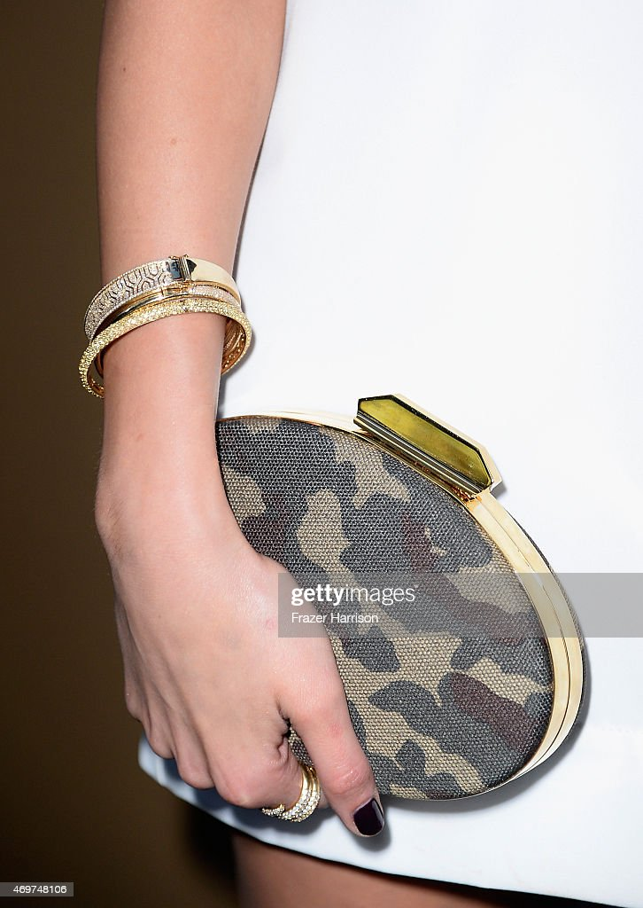 Actress Olivia Culpo jewelry detail attends the Giuseppe Zanotti Beverly Hills Store Opening on April 14 2015 in Beverly Hills California