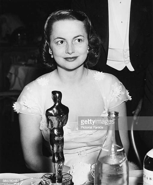 Actress Olivia de Havilland sitting with her Best Actress Oscar at her table for the film 'The Heiress' at the 22nd Academy Awards Los Angeles March...